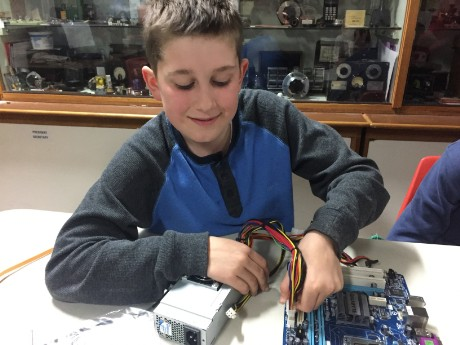 Matthew deconstructing a PC for computer components