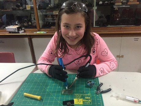 Student using Solder Sucker