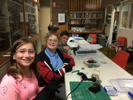 Emilka, Jaimie and Matthew soldering workshop