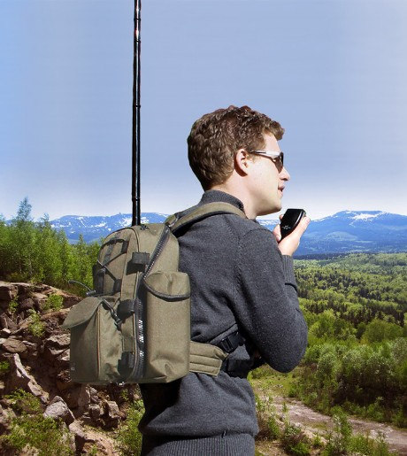 Boy with backpack radio on summit